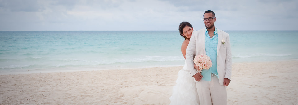 wide shot of bride and groom on sandy mexico beach taken by Cancun wedding photographer
