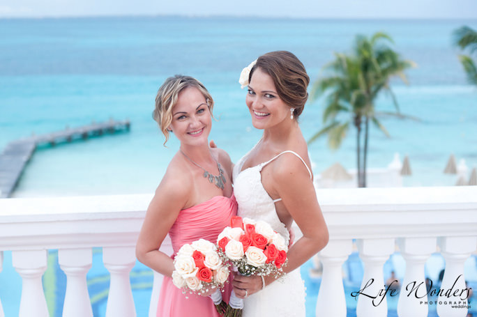 beach wedding hair of bride and bridemaid