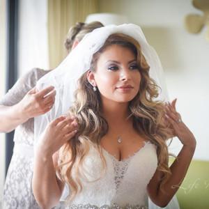 Bride getting dressed by mom