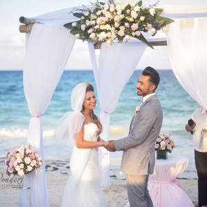 bride and groom in beach wedding ceremony