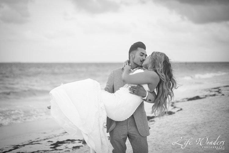 black and white photograph of beach wedding