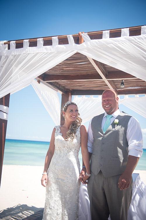 Bride and groom in beach wedding