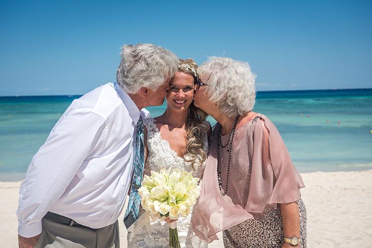 Parents kissing the bride