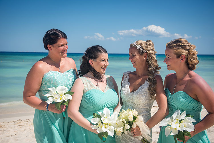 Bride and bridesmaids smiling
