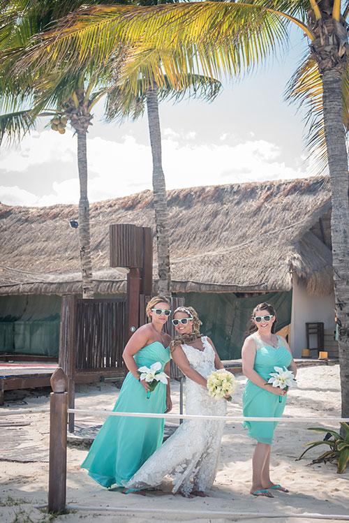 bride and bridesmaids in a beach wedding