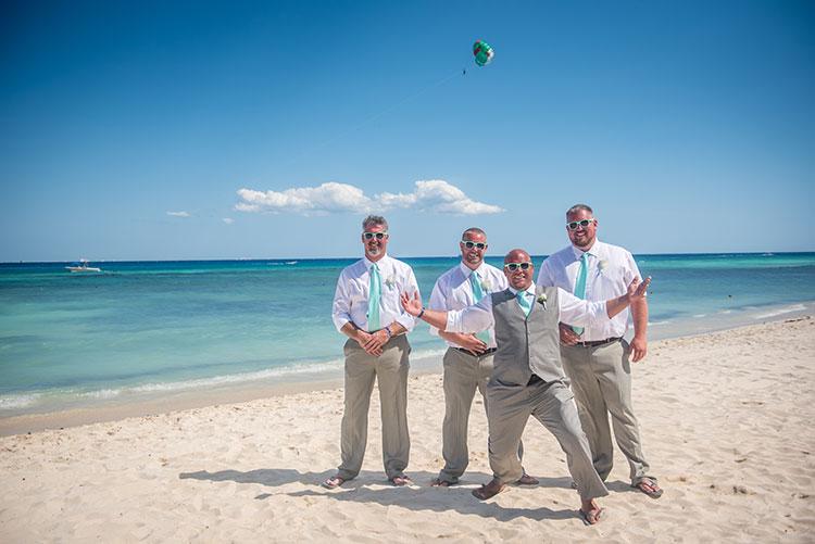 groom and groomsmen in a beach wedding