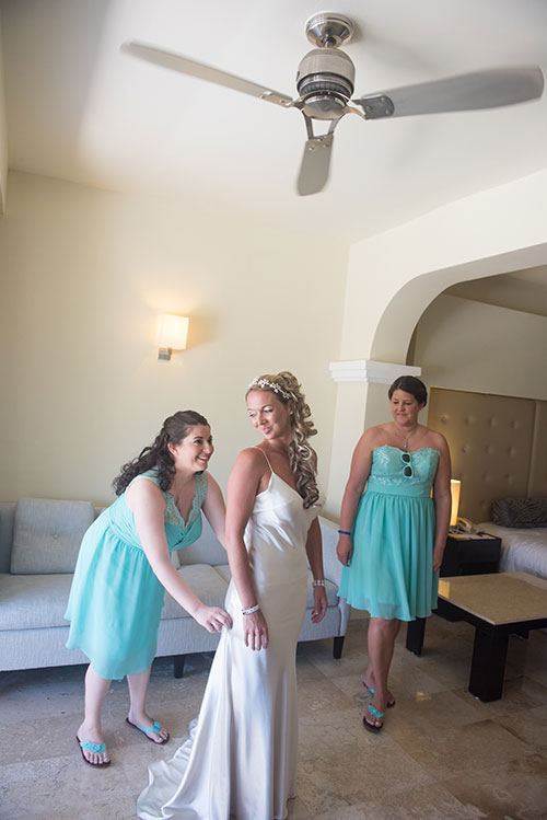 Bride getting dress with bridemaids