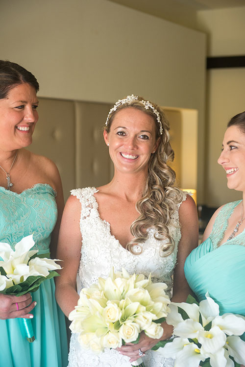 Bride smiling with bridesmaids