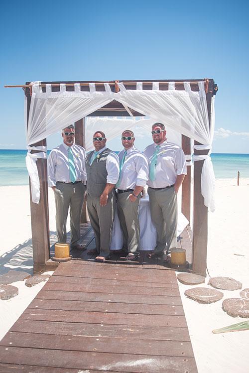 Groom and groomsmen wearing sunglasses