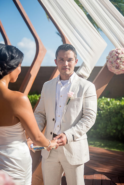 groom in wedding ceremony in cancun