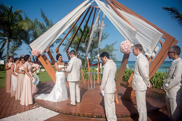 groom putting ring