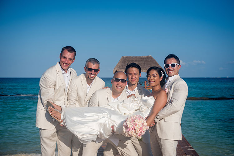 bride and groomsmen in cancun