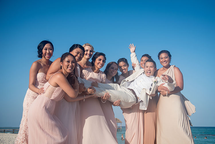 funny portrait of groom and bridesmaids