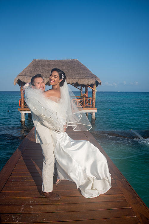 bride and groom having fun in cancun