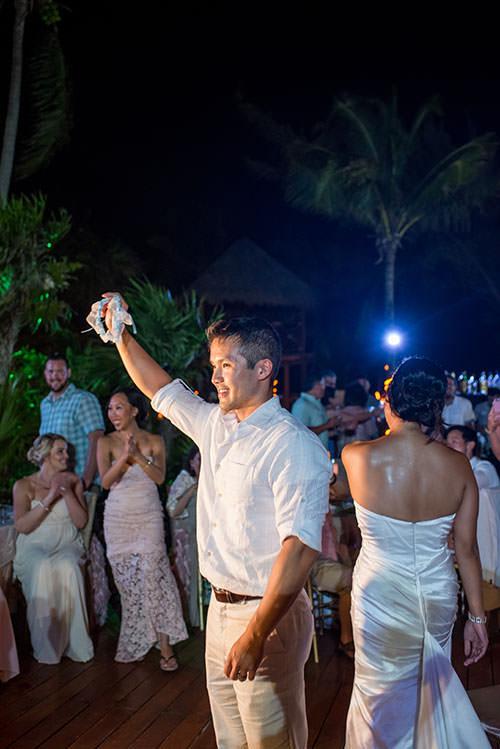 groom with wedding garter belt