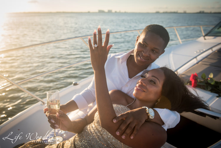 girl showing engagement ring on a boat