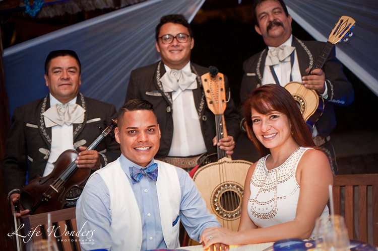 couple with mariachi band