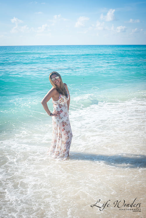 woman in floral dress at cancun beach