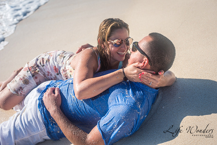 groom & bride embrace each other on the beach - marriage proposals