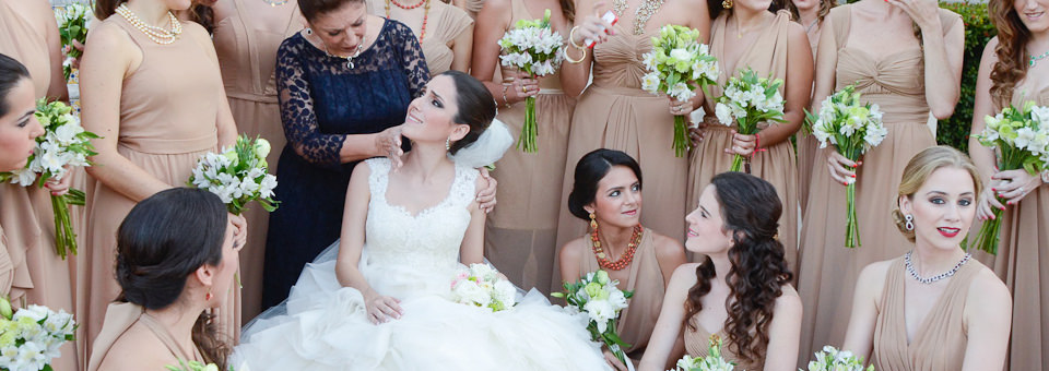 bride pictured with her maids of honour and mother