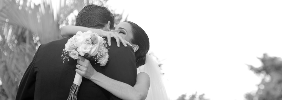 bride and groom embrace each other in black and white photo captured by Cancun wedding photographer; dorota jamal
