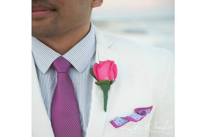 Happy wedding groom beach attire