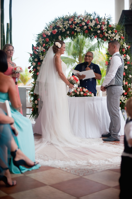 bride & groom take their vows - photographed by Riu Palace Resort wedding photographer