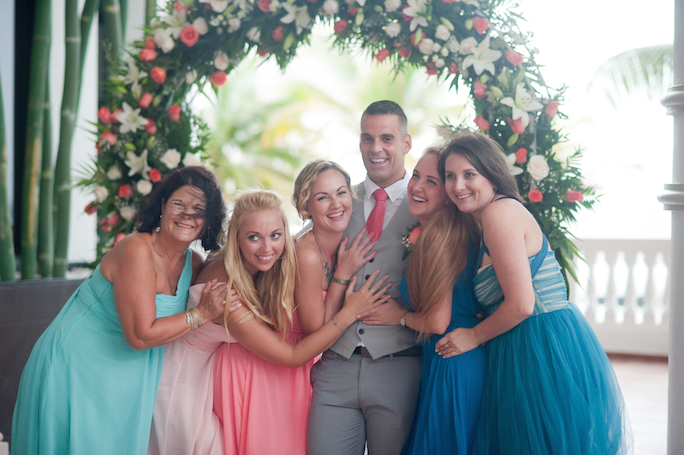 maids of honour & the groom all smile for a group photo - shot by Riu Palace Resort wedding photographer