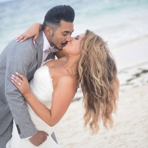 bride and groom kiss in beach wedding - wedding photos