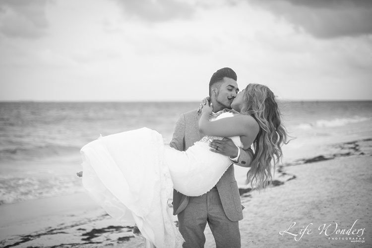 black and white photograph of beach wedding