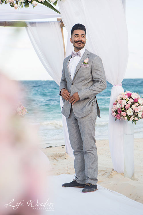 Groom waiting in beach wedding ceremony now sapphire wedding