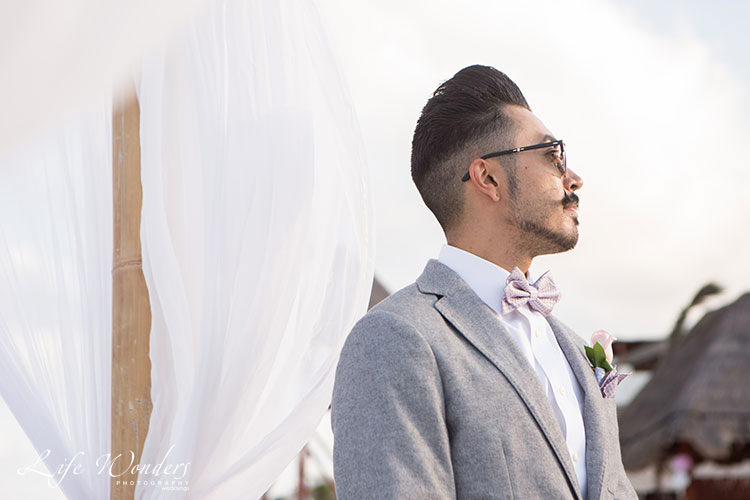 groom with sunglasses at beach ceremony