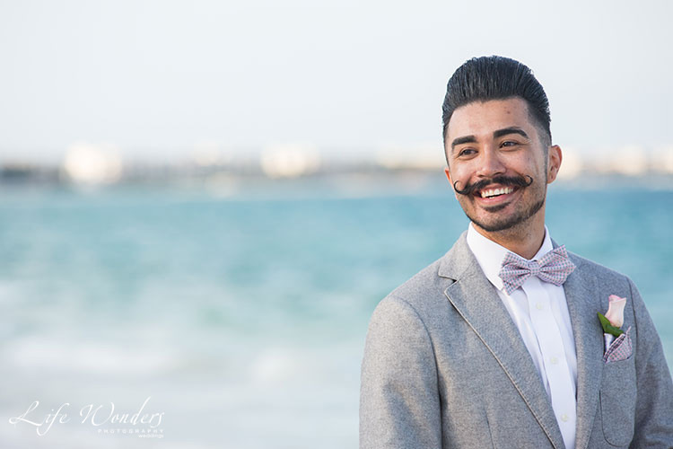 groom attire in beach wedding