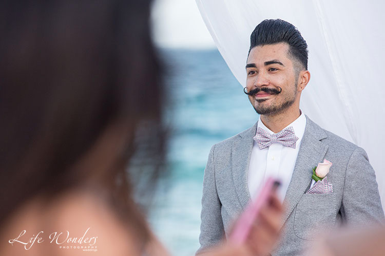Groom in beach wedding ceremony now sapphire wedding