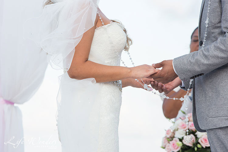 bride and groom holding hands in cancun ceremony