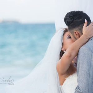 first kiss of newlyweds - wedding photos