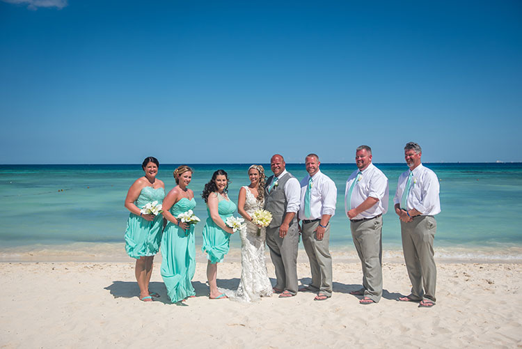 Bridesmaids and groomsmen in the beach