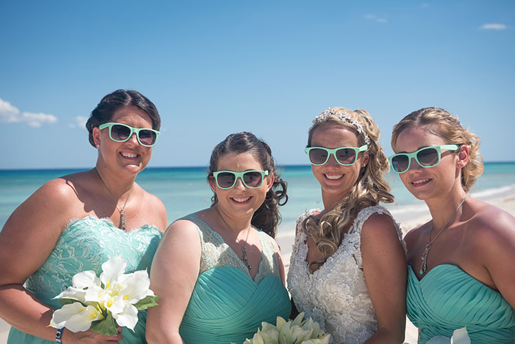Bride and bridesmaids wearing sunglasses