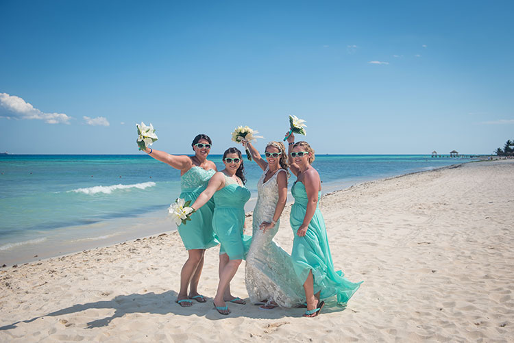 Bride and bridesmaids wearing glasses