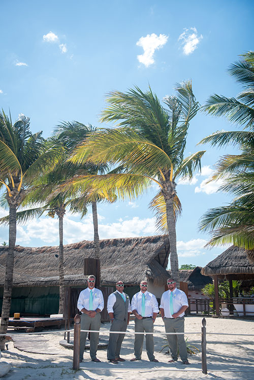 Groom and groomsmen in the beach