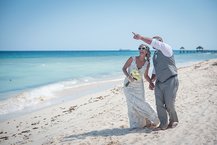 Bride and groom having fun in the beach