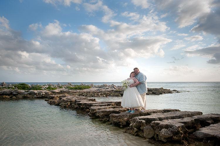 beach backdrop bride and groom