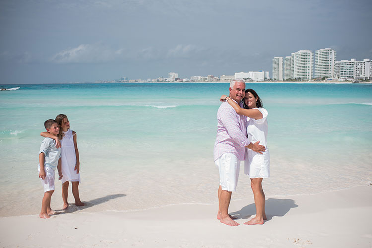 Cindy and family in Cancun beach as backdrop