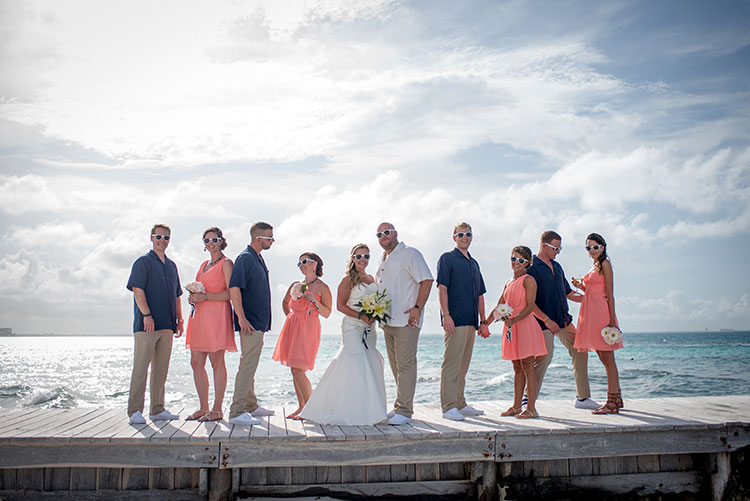 bridal party over a pier in Cancun