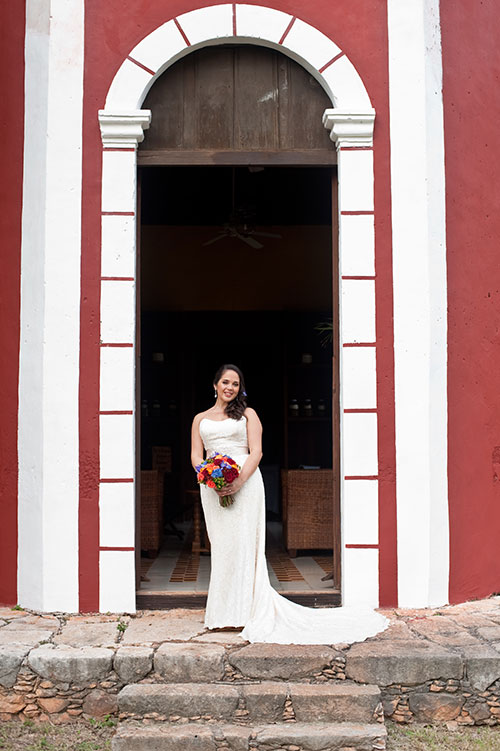 bride in front of a Mexican church