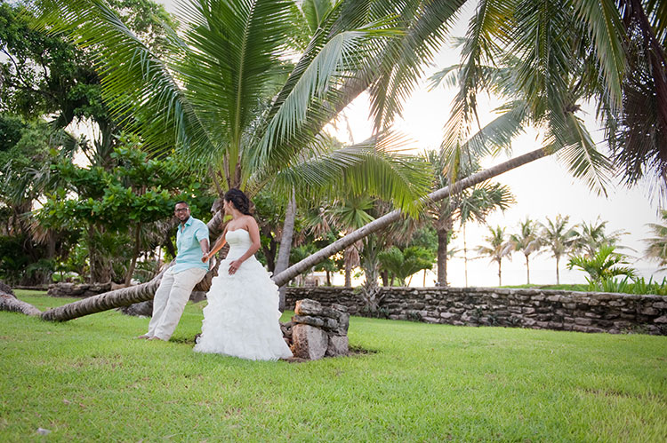 bride and groom surrounded by trees