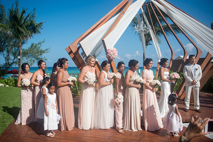 bridesmaids in wedding ceremony - azul fives weddings