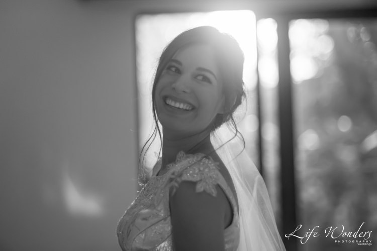 bride smiling during getting dressed photographs - getting dressed
