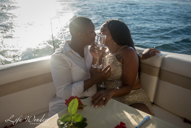 couple drinking champagne on yacht