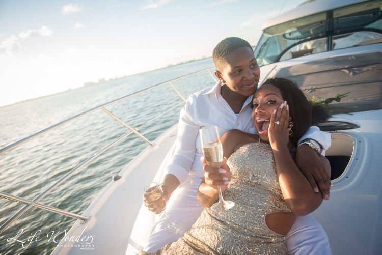 girl surprised by engagement ideas in a yacht
